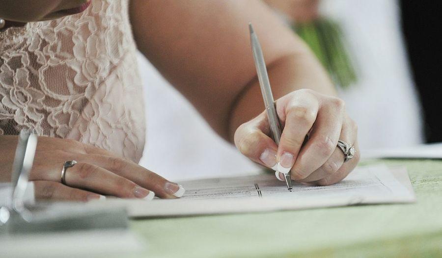 Woman signing on wedding ceremony