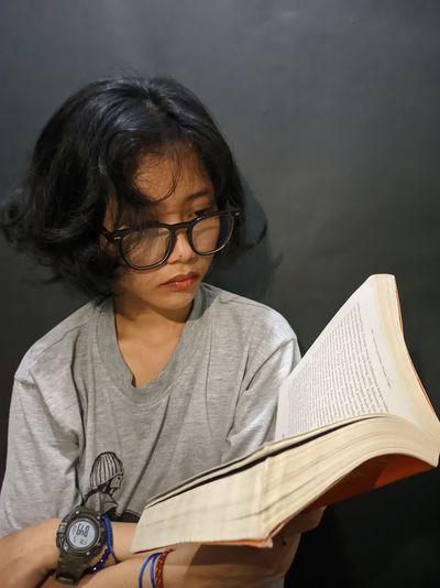 Close-up of girl holding eyeglasses