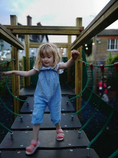 Full Length Of Girl Walking On Footbridge In Playground