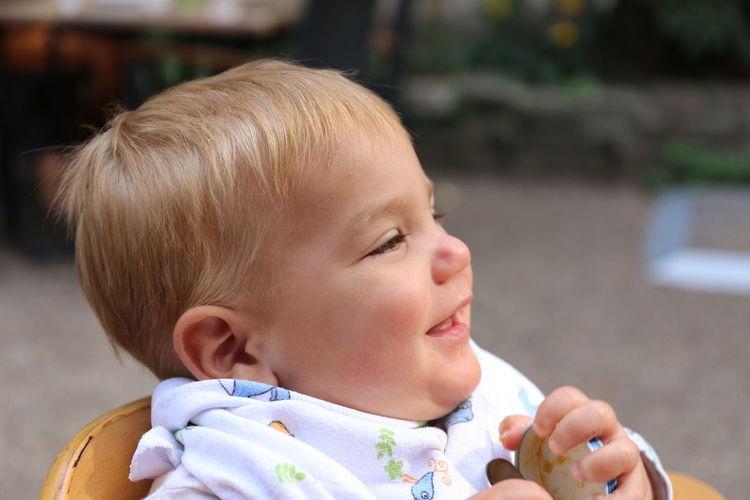 Portrait of cute baby girl looking away outdoors