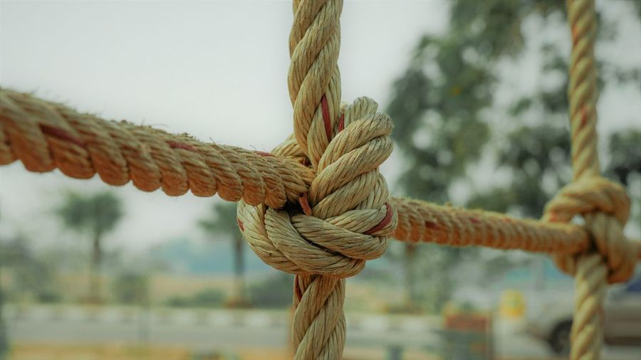 Close-up of rope tied to pole