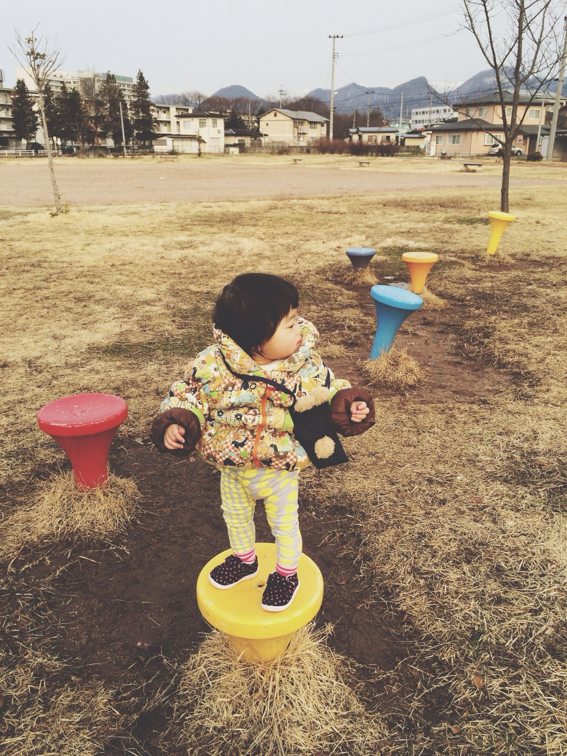 childhood, full length, playground, lifestyles, leisure activity, building exterior, boys, built structure, girls, elementary age, architecture, day, street, swing, playing, park - man made space, casual clothing, outdoors