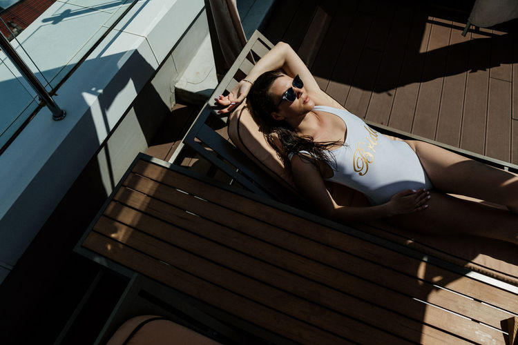 High angle view of woman sitting at the pool