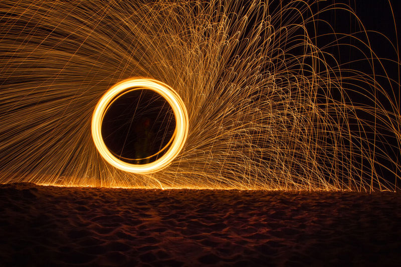 Full Frame Shot Of Illuminated Light Against Sky At Night