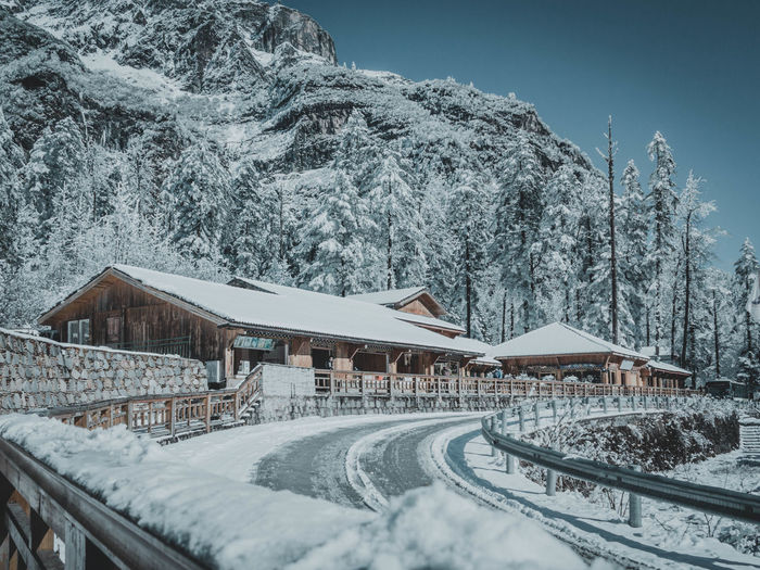 Snow Cold Temperature Winter Mountain Built Structure Tree Nature Beauty In Nature Architecture Day Scenics - Nature Plant No People White Color Building Exterior Transportation Snowcapped Mountain Covering Building Outdoors