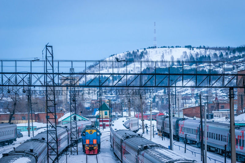 High angle view of trains at depot in winter