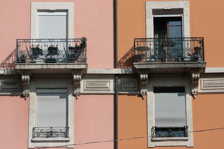 Symetrie Symetry Symmetry Symmetrical Symetrical Pattern Balcony Colors Red Orange Pink Lines Lines And Shapes Shadow Geneva Pâquis Architecture Window Windows Balconies Building Façade EyeEm Selects City Window Residential Building Railing Architecture Building Exterior Built Structure Window Box Balcony