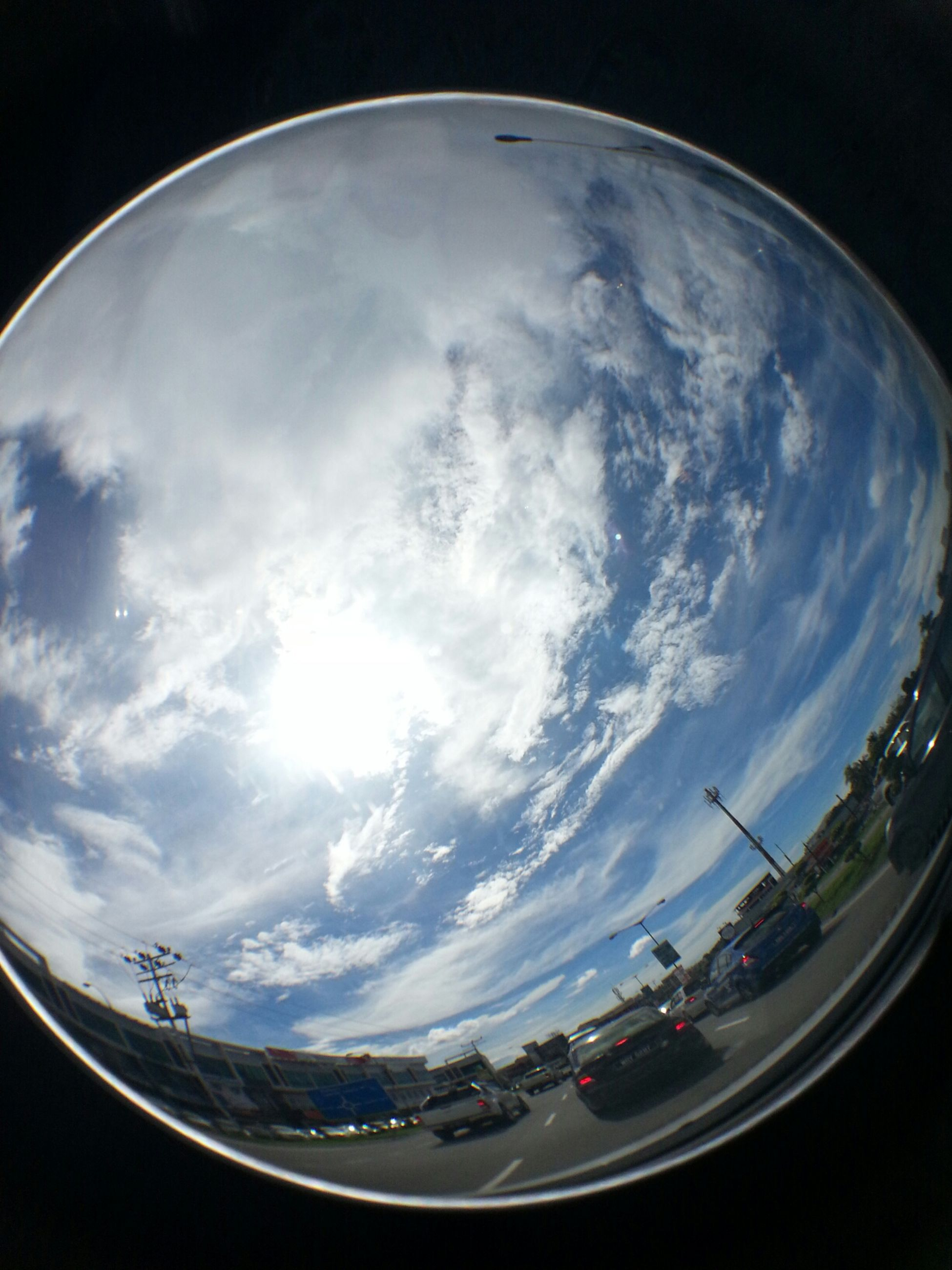 sky, cloud - sky, low angle view, fish-eye lens, circle, cloudy, cloud, transportation, nature, no people, outdoors, day, airplane, air vehicle, scenics, mid-air, glass - material, sunlight, reflection, flying