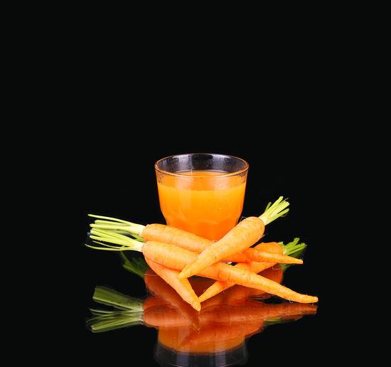 Close-up of orange juice on black background