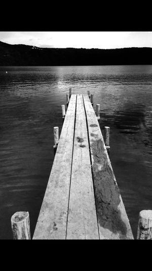 Pier of solitude, Lake Albano, Italy Black & White Black And White Black&white Blackandwhite Blackandwhite Photography Boardwalk Diminishing Perspective Idyllic Jetty Lake Lake Albano Lake View Lakeshore Lakeside Lakeview Nature Pier The Way Forward Tranquil Scene Water Wood Wood - Material Wooden