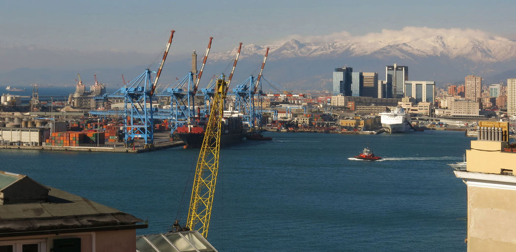 Genoa Genova Tower Crane Architecture Building Exterior Cargo Container City Cityscape Cold Commercial Dock Crane - Construction Machinery Day Harbor Mountains Nautical Vessel No People Outdoors Sea Shipping  Snow Waterfront Windy