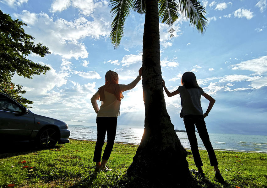 Silhouette. Two girl stand at the coconut tree during sunset Tree Plant Sky Real People Cloud - Sky Nature Two People Palm Tree Standing Leisure Activity Lifestyles Land Beauty In Nature Full Length Tropical Climate Young Women Women Trunk Adult Tree Trunk Outdoors Couple - Relationship