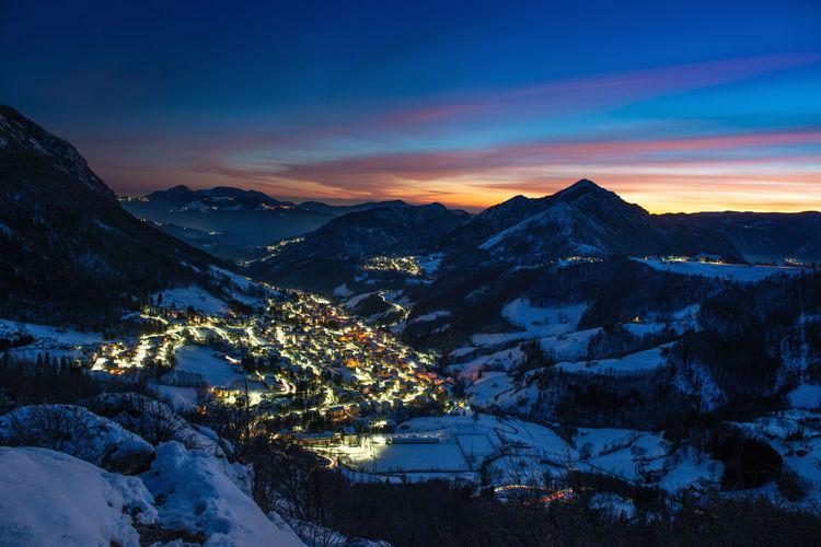Snowy ski resort at sunset