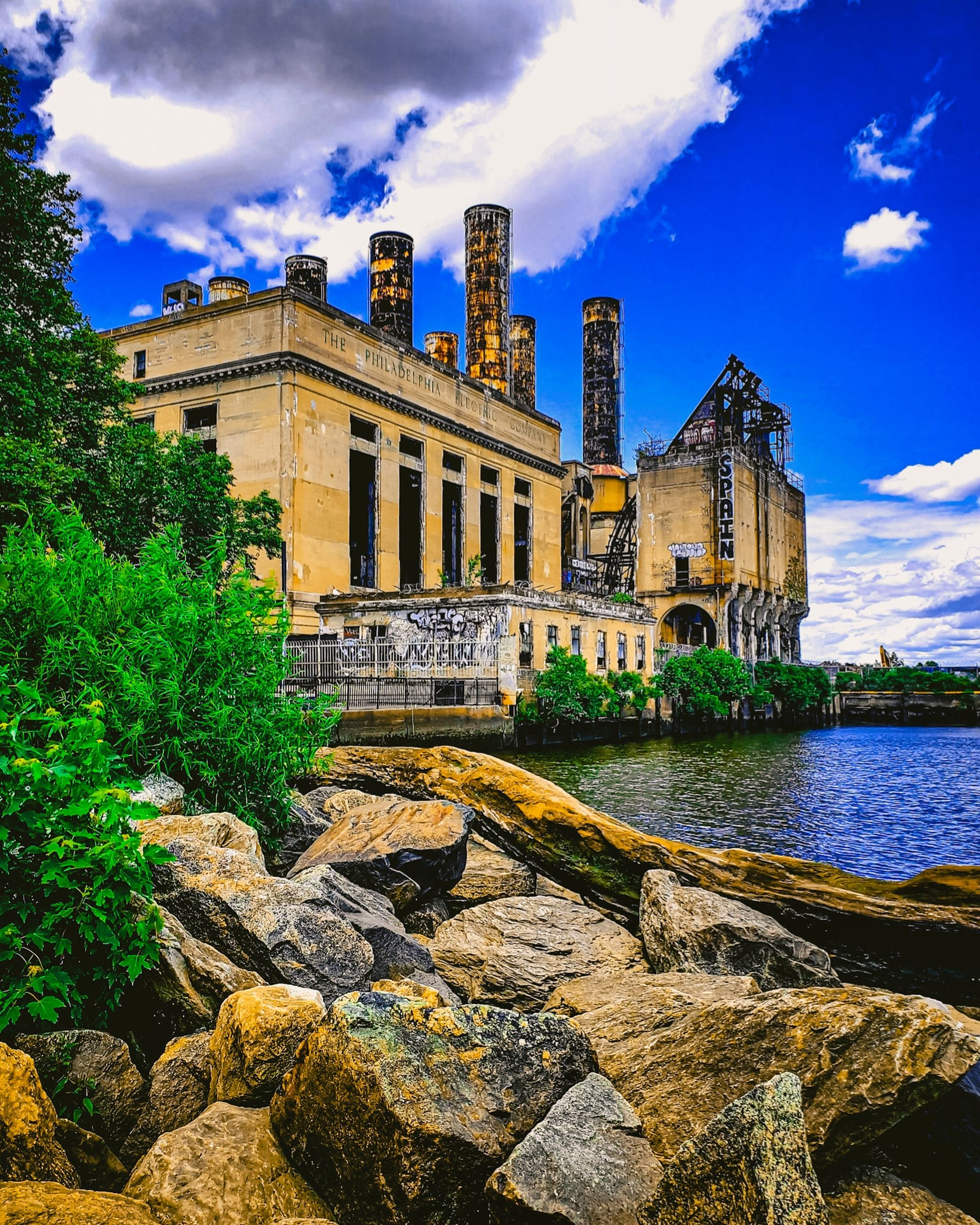architecture, built structure, building exterior, sky, cloud, nature, travel destinations, history, water, the past, building, landmark, castle, château, travel, city, plant, tourism, no people, tree, rock, reflection, vacation, cityscape, blue, outdoors, house, estate, mansion, beauty in nature, river, old, day