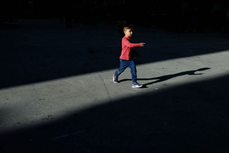 Kid Streetphoto Streetphotography Candid Candid Photography Light And Shadow Portrait Shadows & Lights Streetphoto_color Full Length Child Childhood Sports Clothing Sport Shadow Agility Primary Age Child Caucasian