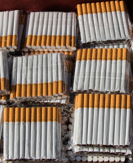 Close-up of cigarettes in row