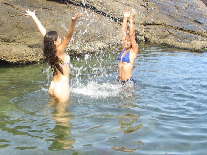 praia do guaraú SP Guarau Arms Raised Bikini Bonding Day Full Length Fun Happiness Human Arm Human Body Part Leisure Activity Nature Outdoors Praia Real People Sea Smiling Summer Togetherness Two People Vacations Water Women Young Adult Young Women