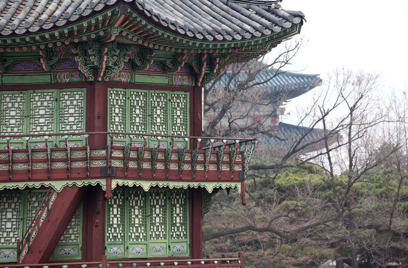 Architectural Feature Architecture Building Exterior Built Structure Clear Sky Day Exterior Famous Place Gyungbok Palace Historic Building Historic Place History House Low Angle View No People Outdoors Palace Place Of Worship Religion Roof Sky Travel Destinations Tree Window Wood - Material