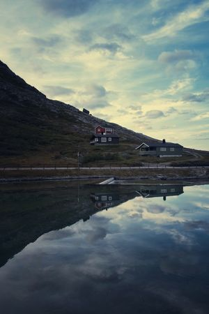 Mirror mirror on the... Nordic Light Trollstigen Thewowseeker Sky Cloud - Sky Water Reflection Tranquil Scene Nature Outdoors Lake Built Structure Beauty In Nature Architecture Day Mountain
