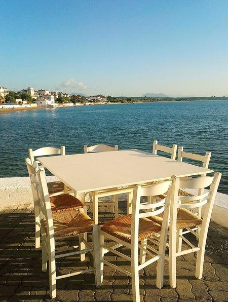 Sea Beach Chair No People Early Morning Beauty In Nature Tranquility Sunlight Sky Summer Memories 🌄 Food And Drink GREECE ♥♥ Taking Photos Travel Photography Tourism Destination Summer ☀ Sunlight Oyzo Greek Food Love Fresh Products Greek Hospitality Holiday And Relaxing