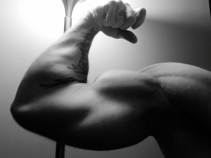 Close-up of man flexing muscles