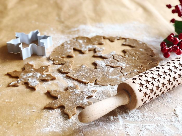 Dough With Pastry Cutter And Rolling Pin On Table