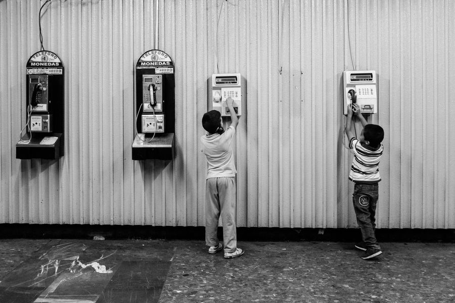 Shot in the Mexico City Subway. Black & White EyeEm Best Shots Streets Black And White Black And White Photography Black&white Blackandwhite Blackandwhite Photography Boys Call Child Childhood Family Full Length Pay Phone People Phone Phones Real People Standing Street Photography Streetphoto_bw Streetphotography Two People Week On Eyeem