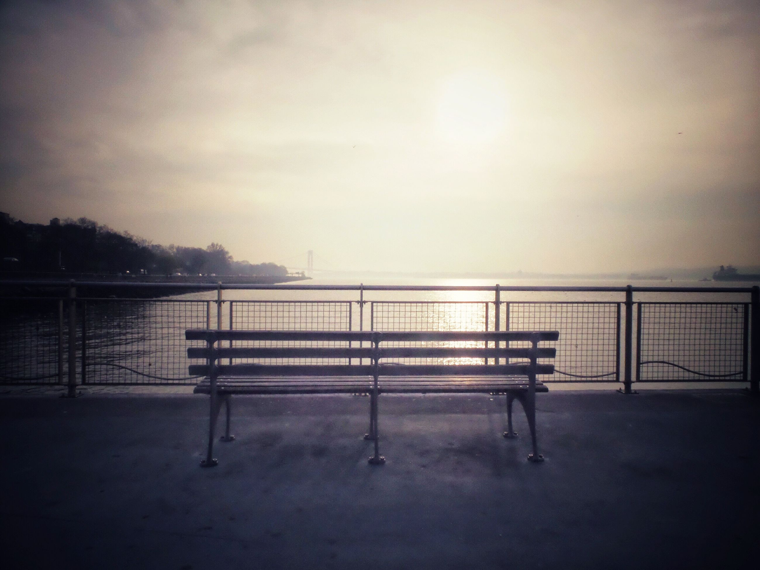 railing, tranquility, tranquil scene, bench, sky, water, empty, nature, scenics, silhouette, absence, beauty in nature, tree, pier, sunset, lake, fence, no people, idyllic, outdoors