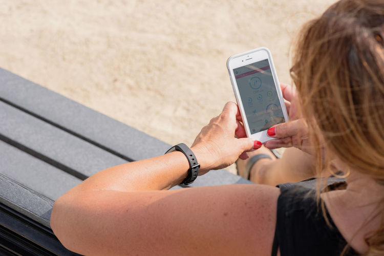 Midsection of woman using smart phone
