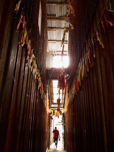 Full length of man walking in decorated corridor