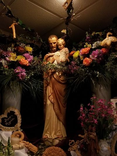 Feast Of Saint Joseph Joseph Religious  darkness and light Tranquil Scene Tranquility Gold Colored Flower Celebration Statue Golden Color Sculpture Sculpted Human Representation Jesus Christ Male Likeness