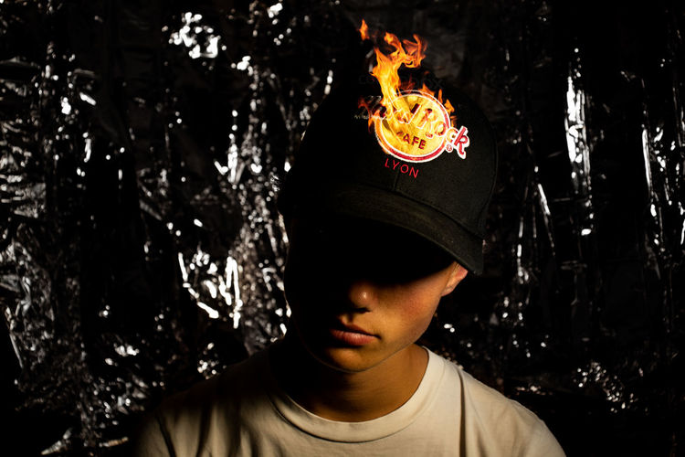 Portrait of boy with fire crackers at night