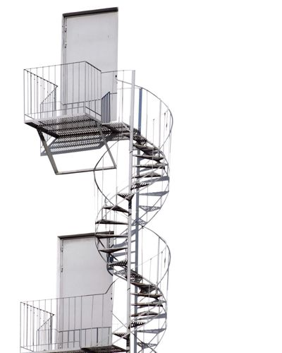 Low angle view of spiral stairs on building
