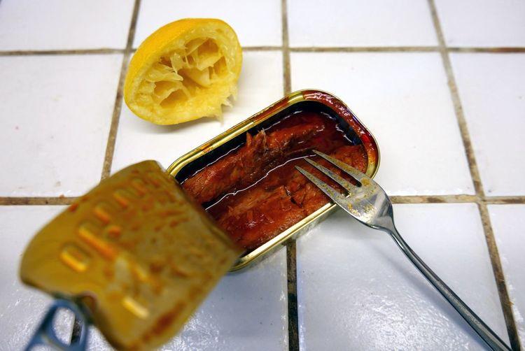 Open tin of fish in tomato sauce