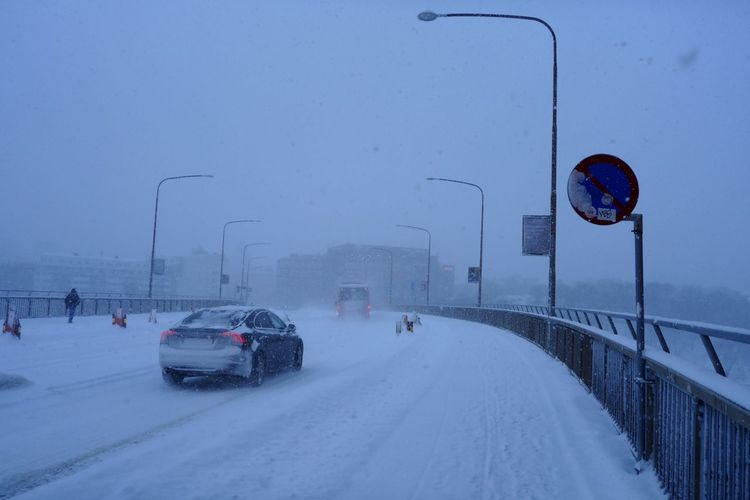 View from Barnhusbron. It's snowing in Stockholm. Snowing Bridge Barnhusbron Traffic Sign Sign Post Sign Snow Winter Car Cold Temperature Transportation Weather Road