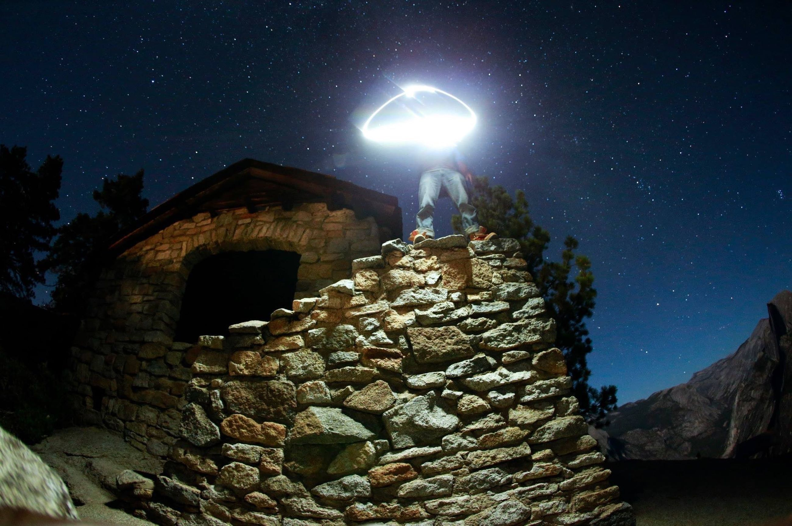night, built structure, architecture, low angle view, sky, building exterior, history, stone wall, illuminated, old, old ruin, clear sky, ancient, the past, outdoors, rock - object, dark, arch, stone material, no people