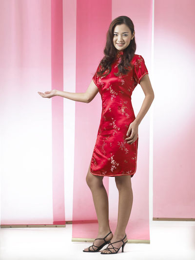 chinese woman wearing red cheongsam Red Happiness Laughing Tradition Traditional Clothing Woman Chinese Chinese New Year Cultural Festival Front View Full Length Gong Xi Fa Chai High Heels Lifestyles Long Hair Looking At Camera One Person Oriental Style Portrait Qipao Smile Traditional Costume Wearing Young Adult