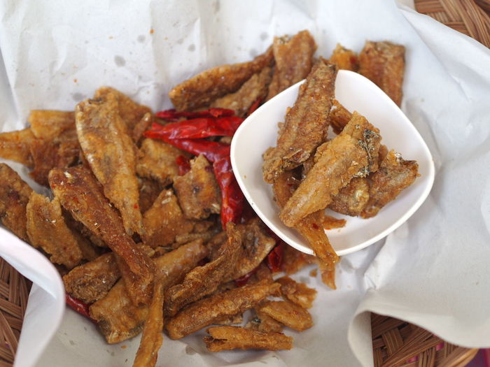 High angle view of fried fish in basket