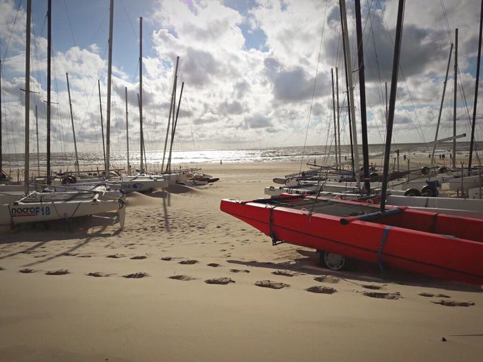 Sailing boats in the Netherlands Iphone6 Betterlandscapes Peaceful Red Boat Sailing Boats Sea Water Cloud - Sky Mode Of Transportation Nature Beach Beauty In Nature Mast Outdoors Tranquility First Eyeem Photo EyeEmNewHere
