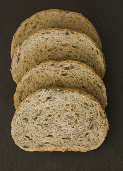 Directly above shot of bread slices on slate