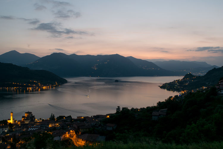 Architecture Beauty In Nature Built Structure City Cityscape Cloud - Sky Idyllic Illuminated Lake Lake Iseo (italy) Landscape Mountain Mountain Range Nature No People Outdoors Residential Structure Scenics Sky Sunset Town TOWNSCAPE Tranquil Scene Tranquility Water