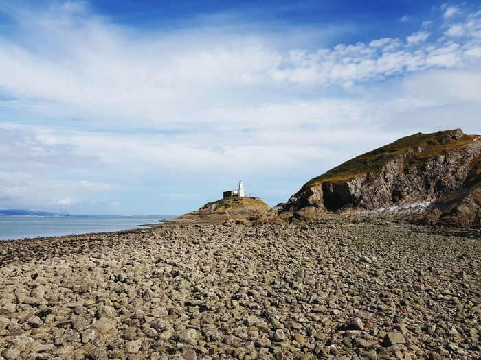 Wales Coast Path The Mumbles Lighthouse Wales Coast Path Sea Beach Rock - Object Sky Landscape Cloud - Sky Cliff Coast Horizon Over Water Ocean Calm Seascape Rocky Coastline