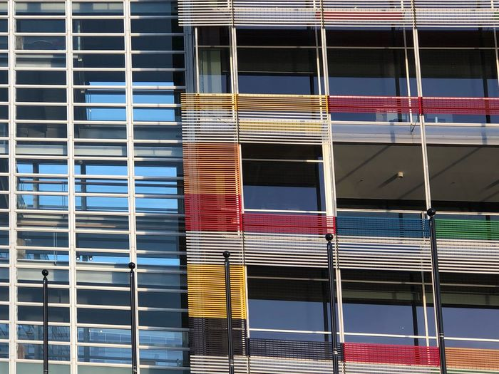 Blue Yellow Red Architectural Detail Lines And Shapes Lines Bright Design Vibrant Color Vibrant Architecture Building Exterior Built Structure No People Full Frame Backgrounds Window Outdoors Pattern Multi Colored Reflection Side By Side Low Angle View City Building Glass - Material Day Metal Sunlight Repetition