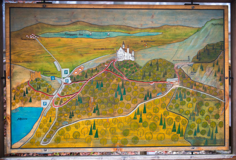 Map in Neuschwanstein Castle, Fussen, Germany Architecture No People Transportation Outdoors Nature Day Map Mode Of Transportation Built Structure Multi Colored Water Tree Environment Art And Craft Travel Cloud - Sky Landscape Building Exterior Motion Creativity