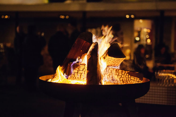 fireplace Atmosphere Burning Fire Fireplace Flame Gathering Heat - Temperature Night No People Outdoors Wood