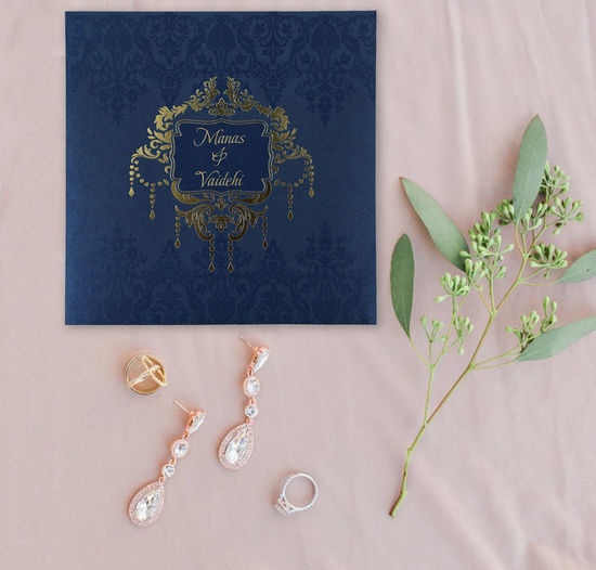 View our stunning collection of new arrivals. This blue color will give a touch of elegance to your wedding. This floral design on shimmer papar make this more elegant and romantic wedding invitation. Set the tone of your wedding with this floral wedding invitation This design from the Crafty Pie Collection at 123WeddingCards is entirely customizable. Shop here @ https://www.123weddingcards.com/card-detail/D-1777 Floral Wedding Invitations Wedding Cards Online Wedding Cards Wedding Invitation Cards Wedding Invitations