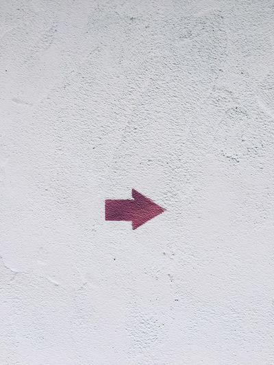 Graffitti in Porto Vechio, Corsica Wall Blank Space Point Signal Minimal Idea Red No People Day Close-up High Angle View White Color Print Outdoors Wall - Building Feature Symbol Creativity