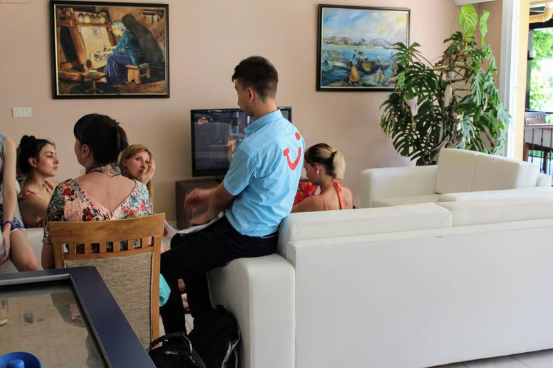 Kleopatra Beach Hotel Tui Adult Boys Casual Clothing Childhood Day Domestic Life Full Length Hotel Indoors  Kleopatra Beach Leisure Activity Lifestyles Living Room Mammal Men Mid Adult Mid Adult Men People Real People Sitting Sofa Togetherness Young Adult