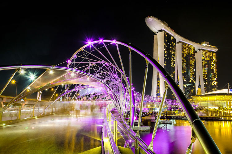 Marina Bay Sands , Singapore Light Marina Bay Sands Marina Bay Sands Hotel Marina Bay Sands Singapore Singapore Singapore View Architecture Arts Culture And Entertainment Blurred Motion Bridge Bridge - Man Made Structure Building Exterior Built Structure City Connection Glowing Illuminated Long Exposure Long Exposure Night Photography Motion Nature Night No People Outdoors Singapore City Speed Travel Destinations Water
