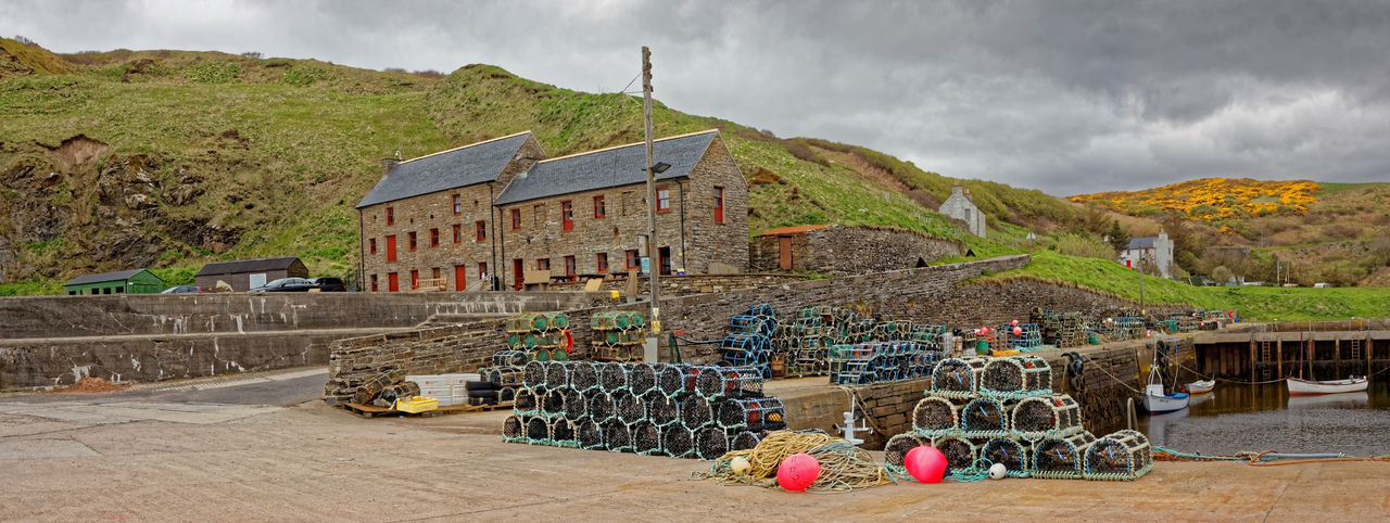 Lybster Harbour Scotland Lybster Neil Gunn Scotland Ancient Civilization Architecture Building Building Exterior Built Structure Caithness Cloud - Sky Fishing Fishing Industry Highlands Of Scotland History Lobster Pots Mountain Nature Outdoors Panoramic Scenics - Nature Sky Tourism Travel Travel Destinations Vivid International